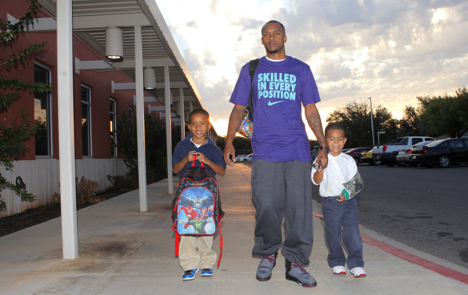 Richie Johnson walks his sons Richie, Jr., 5, and Romeo, 4, to school during Take Your Child to School Day at Martin Luther King Elementary School, Friday, September 21, 2001.   Six Oklahoma City Public Schools will be part of the inaugural event. Photo By David McDaniel/The Oklahoman