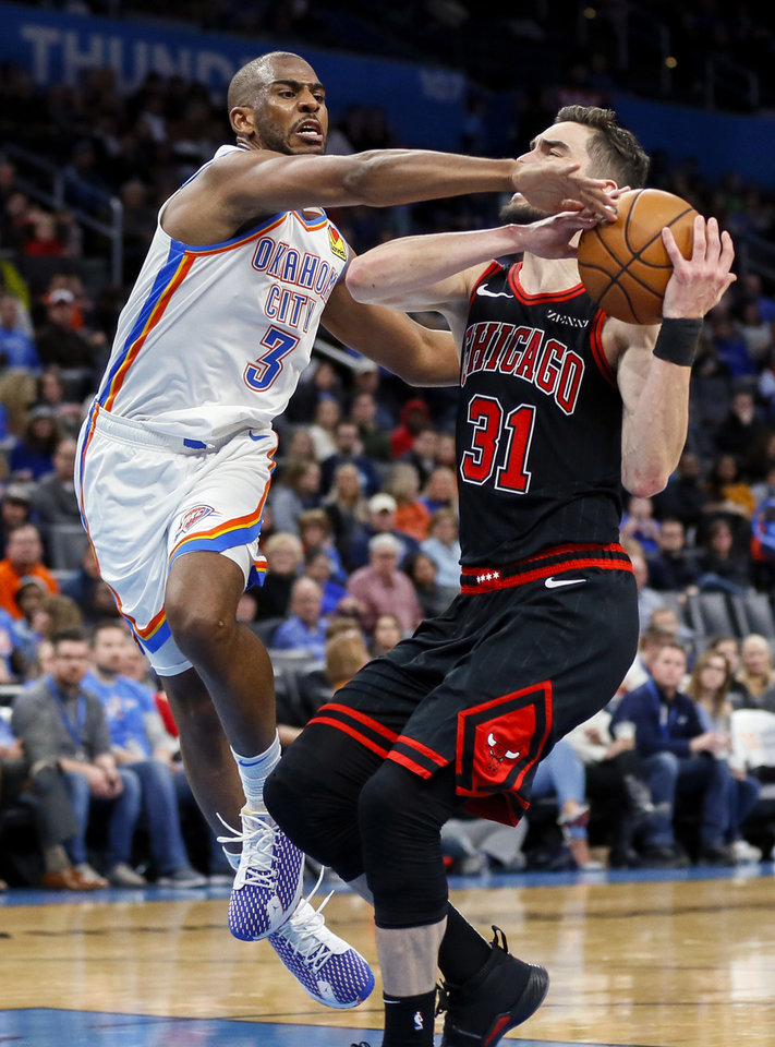 Photo - Oklahoma City's Chris Paul (3) defends Chicago's Tomas Satoransky (31) in the third quarter during an NBA basketball game between the Oklahoma City Thunder and Chicago Bulls at Chesapeake Energy Arena in Oklahoma City, Monday, Dec. 16, 2019. Oklahoma City won 109-106. [Nate Billings/The Oklahoman]