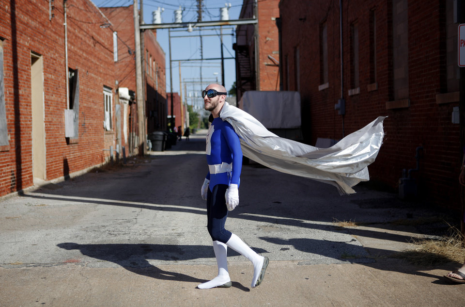 Tom Kenworthy from Tulsa, dressed as Cerulian Bolt, walks the streets of downtown Pauls Valley during International Superhero Day, Saturday, August 4, 2012.  With 124 superheroes taking part, the event attempted to set a world record for the most people in original superhero costumes in one place. The Toy & Action Figure Museum organized the day which also featured a superhero scavenger hunt, super fashion show, and a superhero party. Photo by Bryan Terry, The Oklahoman