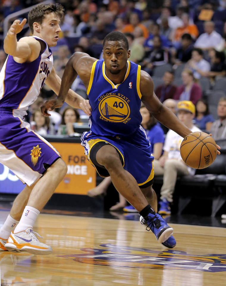 Golden State Warriors' Harrison Barnes, right, drives against Phoenix Suns' Goran Dragic, of Slovenia, during the first half of an NBA basketball game on Friday, April 5, 2013, in Phoenix. (AP Photo/Matt York)