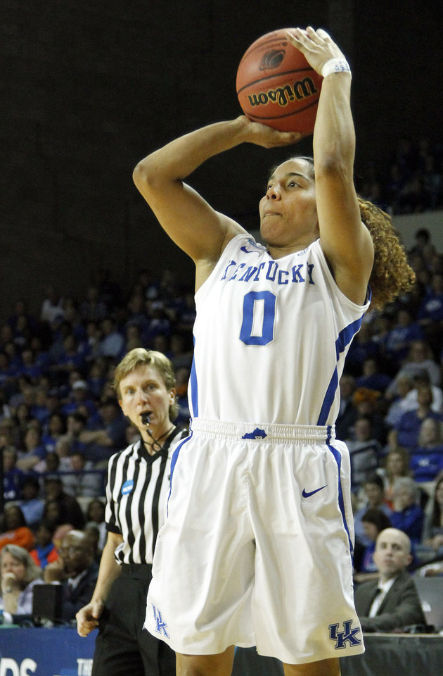 Photo - Kentucky's Jennifer O'Neill shoots an uncontested 3-point shot during the second half of a first-round game against Wright State in the NCAA women's college basketball tournament in Lexington, Ky., Saturday, March 22, 2014. Kentucky won 106-60. (AP Photo/James Crisp)