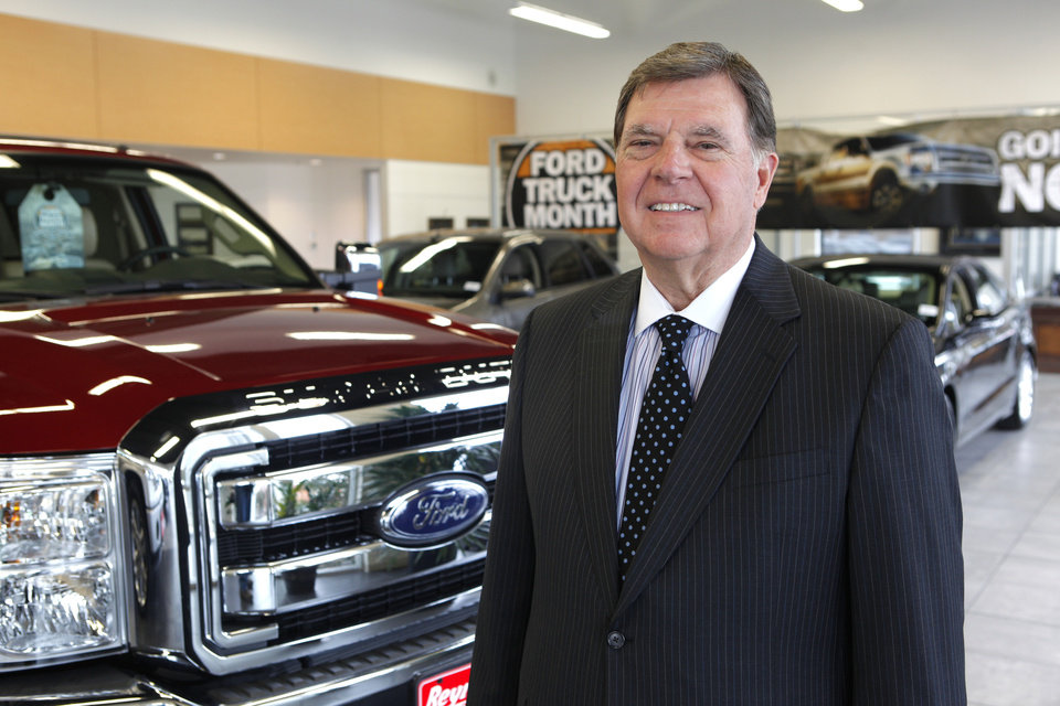 Photo -      Dale Daniels is president and owner of Reynolds Auto Group. He is in his Ford showroom in Edmond. Photo by David McDaniel, The Oklahoman   David McDaniel -