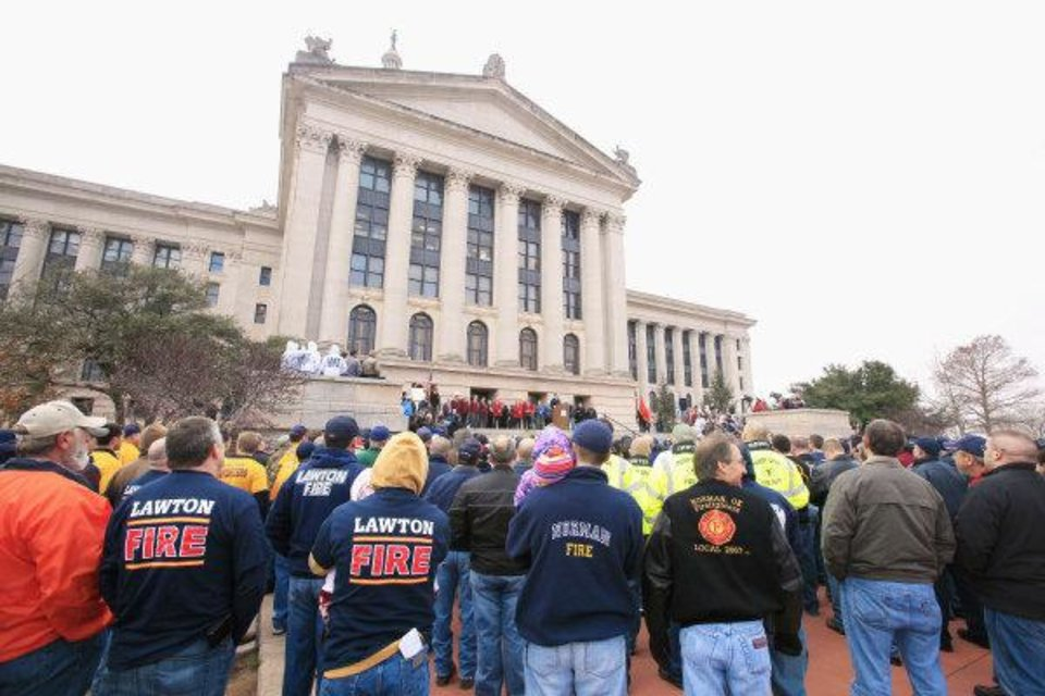Photo - ORG XMIT: KOD Oklahoma firefighters gather during a rally to protest legislation affecting their pension benefits during a rally on the north steps of the state Capitol in Oklahoma City Wednesday, March 9, 2011. Photo by Paul B. Southerland, The Oklahoman