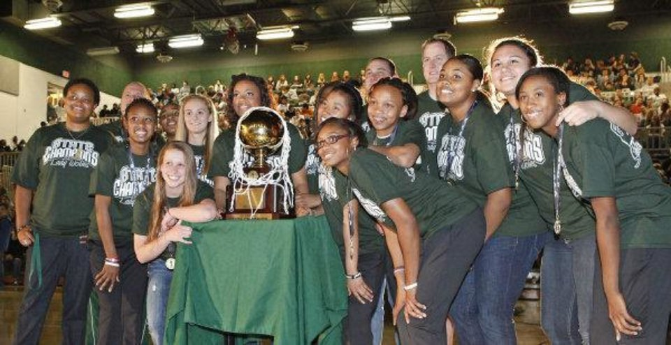 Edmond Santa Fe girls basketball team pose with their trophy during an assembly celebrating their State Championship, Friday, March 25, 2011. Photo by David McDaniel, The Oklahoman <strong>David McDaniel</strong>