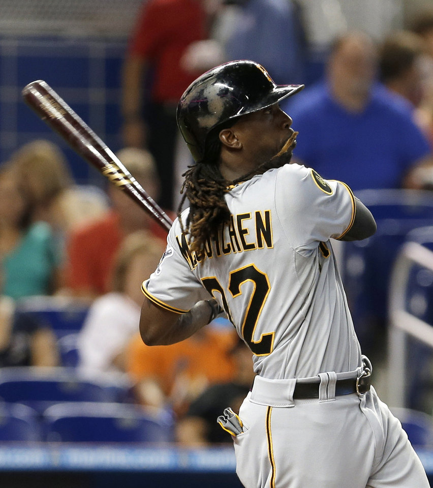 Photo - Pittsburgh Pirates' Andrew McCutchen follows through on his three-run home run against the Miami Marlins in the fourth inning of a baseball game in Miami, Saturday, June 14, 2014. Chris Stewart and Gregory Polanco scored. (AP Photo/Alan Diaz)