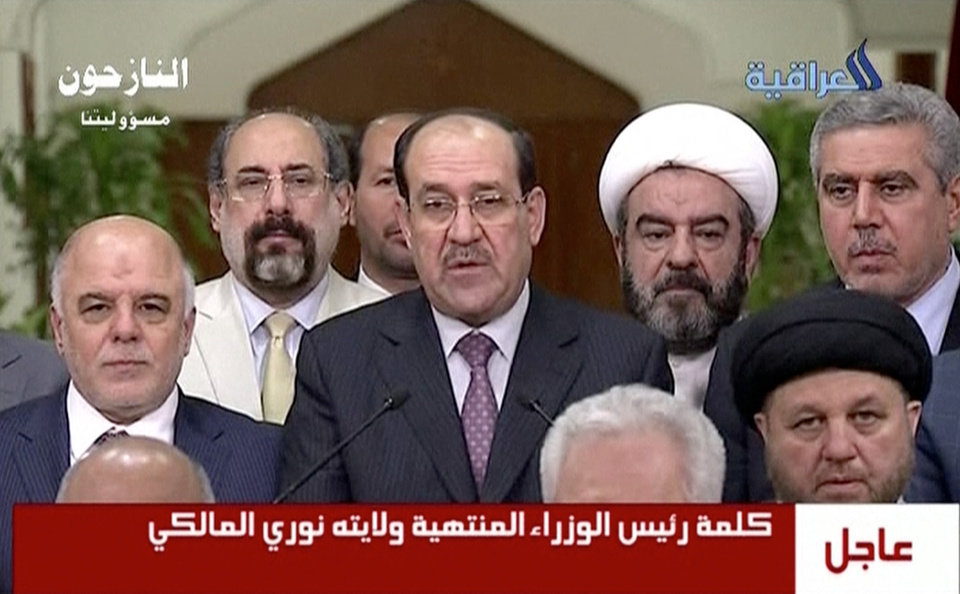 "Photo - In this image taken from video, Iraq's prime minister  for the past eight years, Nouri al-Maliki,  relinquishes his post to fellow Dawa Party member Haider al-Abadi, Thursday, Aug. 14, 2014, ending a political deadlock that has plunged the country into uncertainty as it fights a Sunni militant insurgency. Al-Maliki said the decision to back al-Abadi reflected his desire to ""safeguard the high interests of the country,"" adding that he would not be the cause of any bloodshed. (AP Photo/Al Iraqiya via Associated Press Television) IRAQ OUT"