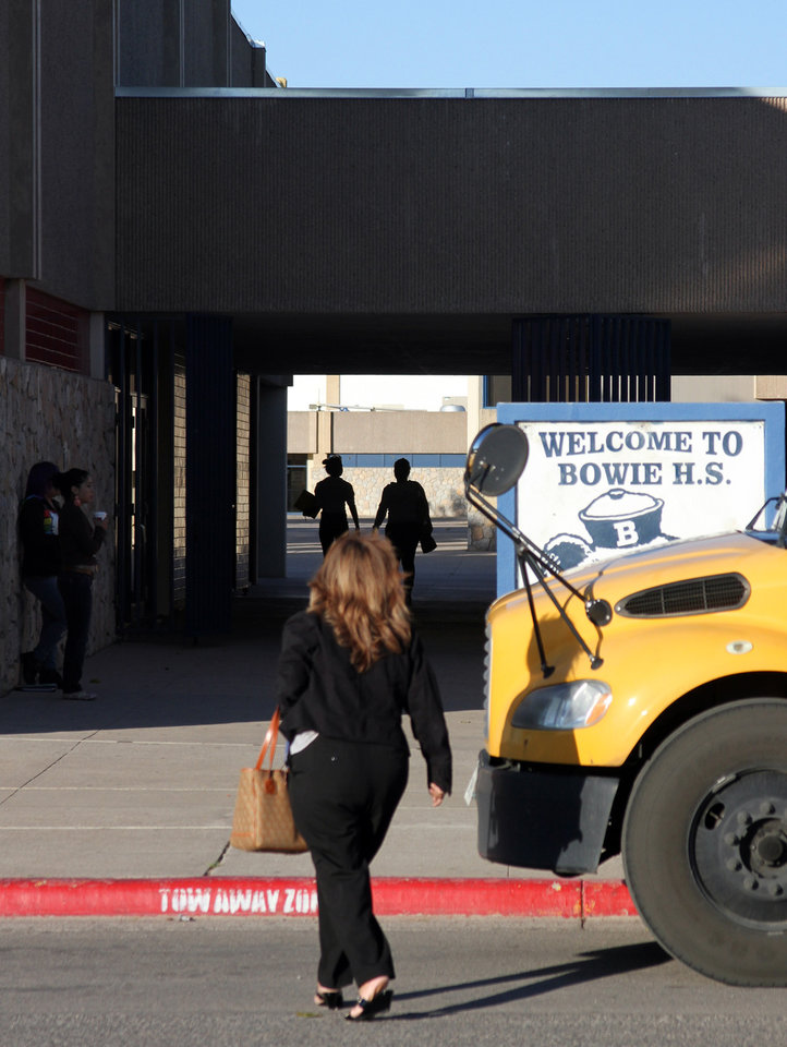 In a Tuesday, Sept. 18, 2012 photo, an unidentified woman enters Bowie High School, the epicenter of a cheating scandal in the El Paso Independent School District, in El Paso, Texas. A cheating scandal in which schools would get rid of underperforming students to artificially inflate their high stakes test scores has rocked the El Paso ISD, landed a former superintendent in jail and prompted the Texas Education Agency to put the district on probation.(AP Photo/Juan Carlos Llorca)