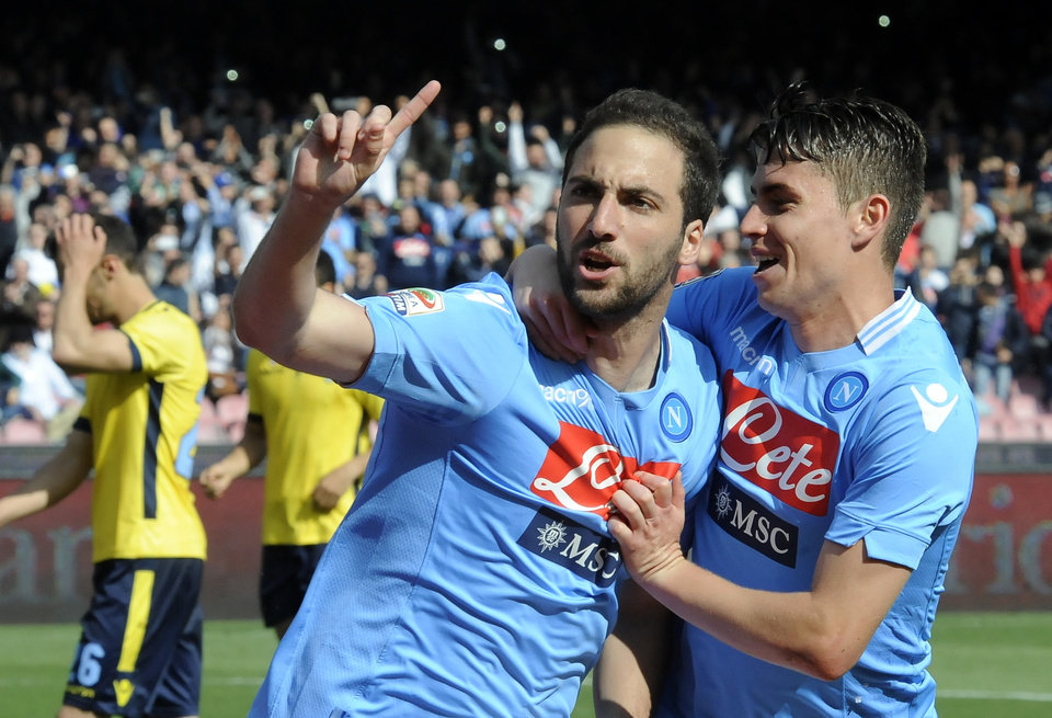 Photo - Napoli's Gonzalo Higuain, left, celebrates with teammate Jorginho after scoring during a Serie A soccer match between Napoli and Lazio, at the San Paolo stadium in Naples, Italy, Sunday, April, 13, 2014. (AP Photo/Salvatore Laporta)
