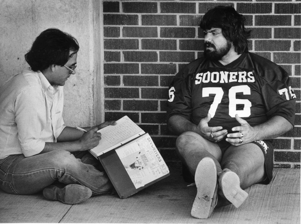 "OU football player Steve ""Dr. Death"" Williams takes it easy in the shade while being interviewed by Rex Holt of the Stillwater News-Press Sept. 1, 1982. Staff photo by Jim Beckel, The Oklahoman"