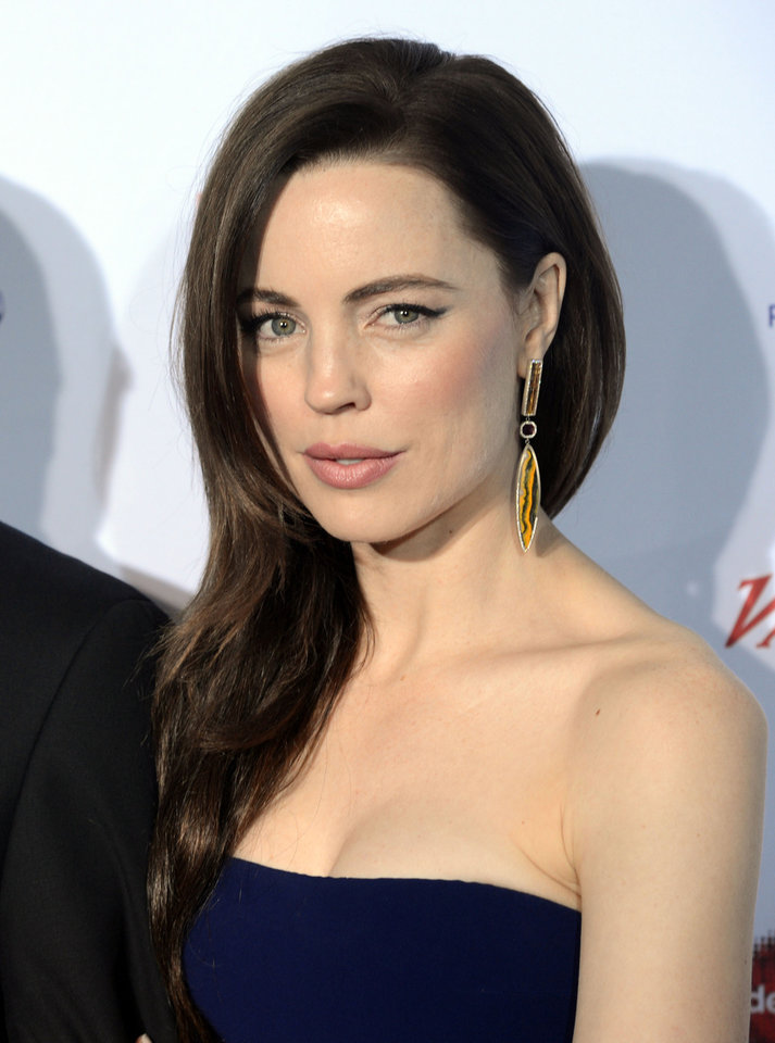 Photo -   Australian actress Melissa George arrives at the 40th International Emmy Awards, Monday, Nov. 19, 2012 in New York. (AP Photo/Henny Ray Abrams)