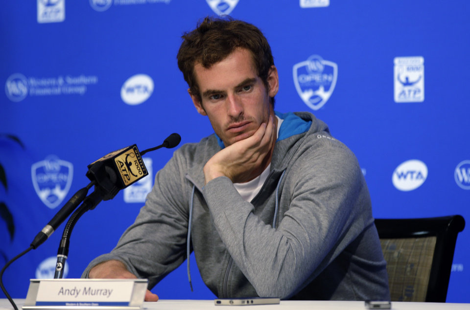 Photo - Andy Murray, of Great Britain, answers questions during a news conference at the Western & Southern Open tennis tournament, Sunday, Aug. 10, 2014, in Mason, Ohio. Murray, the eighth seed, has won the event two times. (AP Photo/Al Behrman)