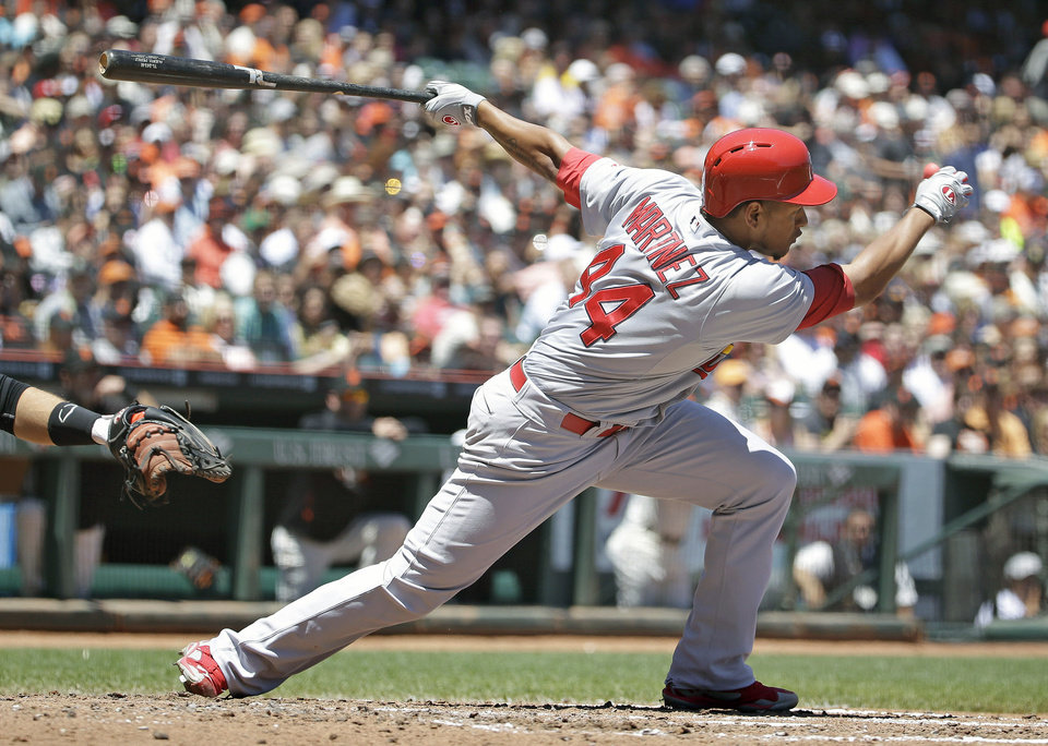 Photo - St. Louis Cardinals' Carlos Martinez hits a two-RBI single off San Francisco Giants starting pitcher Madison Bumgarner in the fourth inning of a baseball game on Thursday, July 3, 2014, in San Francisco. (AP Photo/Eric Risberg)