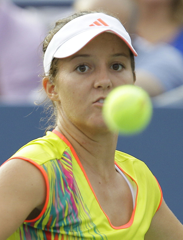 Photo -   Britain's Laura Robson returns a shot to Samantha Stosur, of Australia, in the third round of play at the 2012 US Open tennis tournament, Sunday, Sept. 2, 2012, in New York. (AP Photo/Kathy Willens)