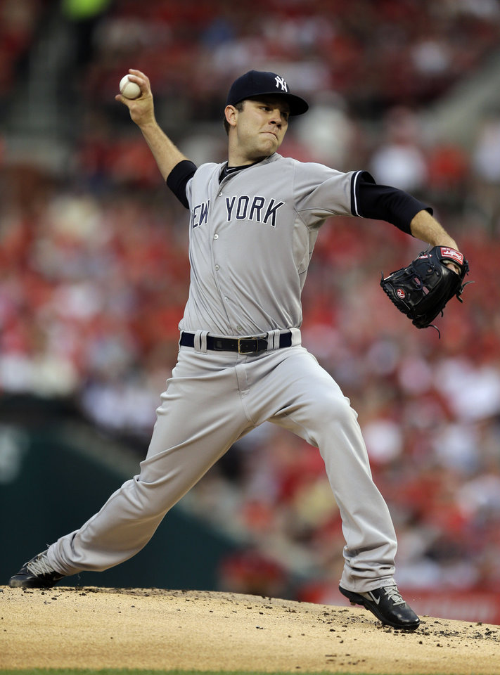Photo - New York Yankees starting pitcher David Phelps throws during the first inning of a baseball game against the St. Louis Cardinals on Tuesday, May 27, 2014, in St. Louis. (AP Photo/Jeff Roberson)