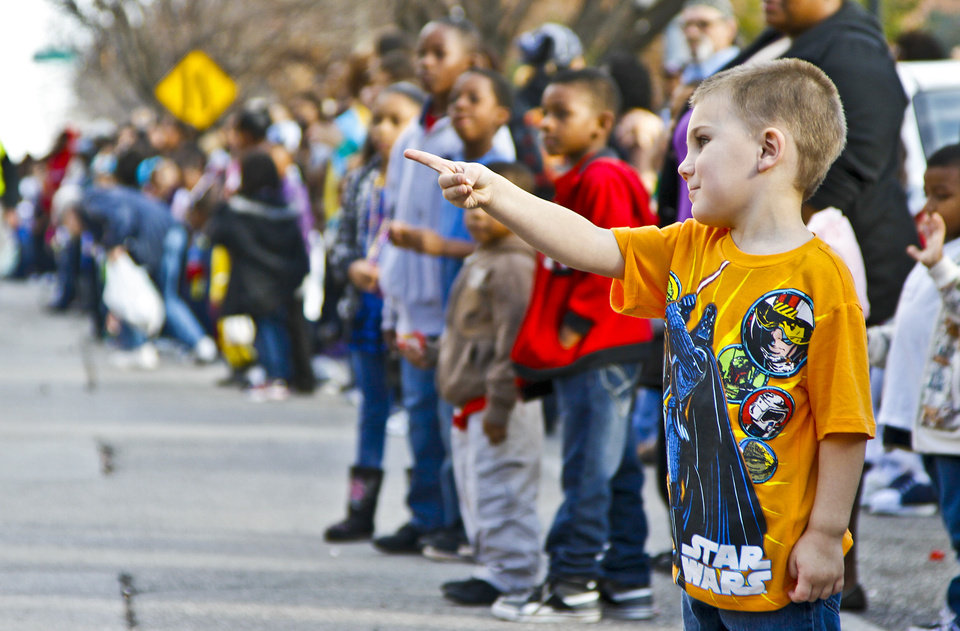 Photo - Ezra Andrews, 4, points to a float as it passes by during Martin Luther King Jr. Day parade through downtown Oklahoma City on Monday, Jan. 16, 2012, in Oklahoma City, Okla. Photo by Chris Landsberger, The Oklahoman
