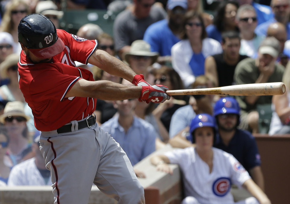 Photo - Washington Nationals' Anthony Rendon hits an one-run triple against the Chicago Cubs during the eighth inning of a baseball game in Chicago, Saturday, June 28, 2014.  (AP Photo/Nam Y. Huh)
