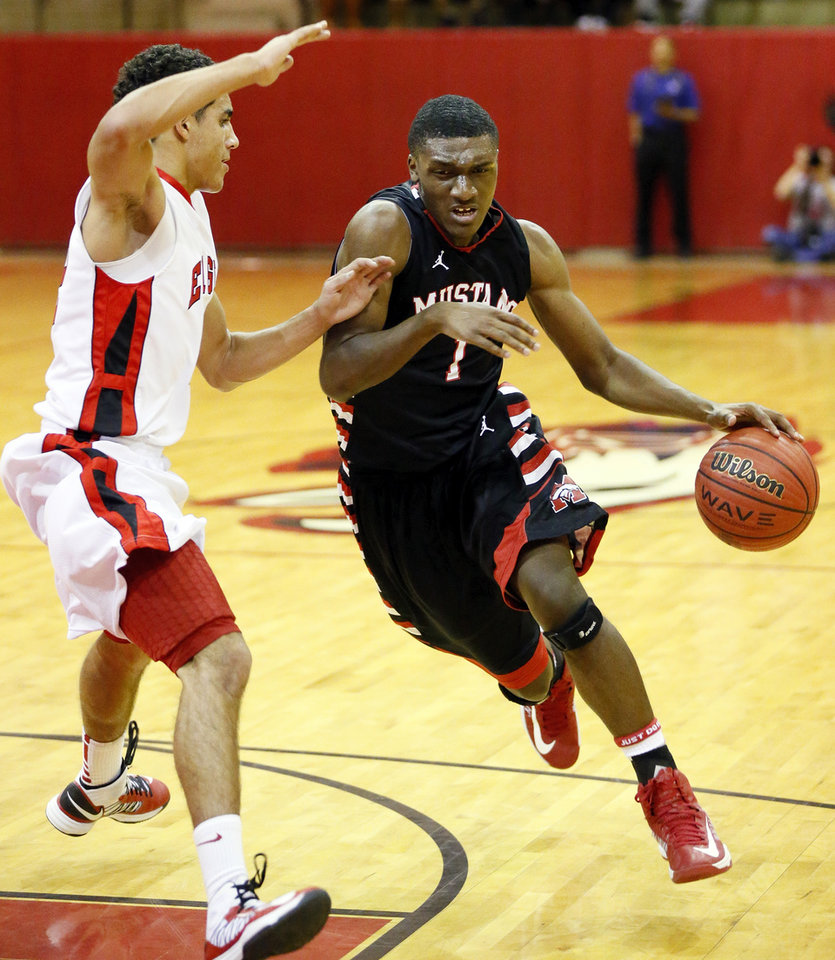 Mustang's Jakolby Long (1) drives against Del City's Brett Cannon (22) during a high school basketball between Del City and Mustang at Del City High School in Del City, Okla., Thursday, Dec. 27, 2012.  Photo by Nate Billings, The Oklahoman