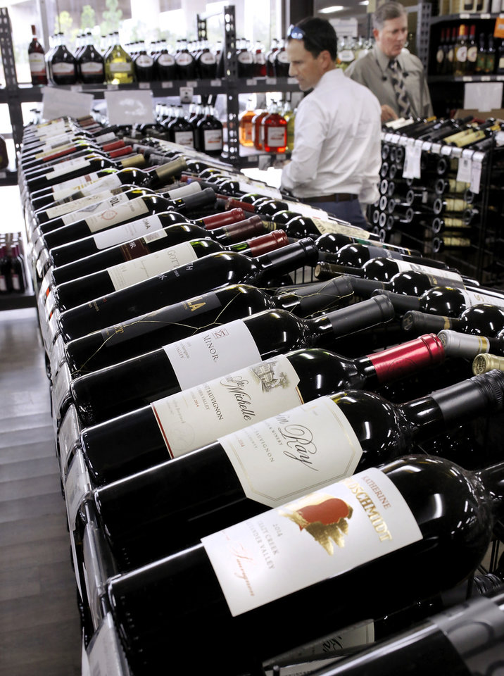 Photo -  A selection of wine is shown at Byron's Liquor Warehouse, Wednesday, Oct. 12, 2016. Liquor store owners fear sales will decline if grocers are allowed to sell wine in the state. [Photo by Jim Beckel, The Oklahoman]