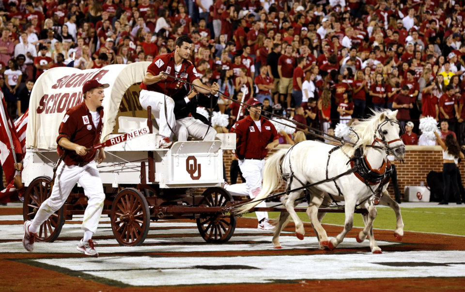 Photo - The Sooner Schooner makes a trip after a score during the second half of the college football game where the University of Oklahoma Sooners (OU) defeated the University of Kansas Jayhawks (KU) 52-7 at Gaylord Family-Oklahoma Memorial Stadium in Norman, Okla., on Saturday, Oct. 20, 2012. Photo by Steve Sisney, The Oklahoman