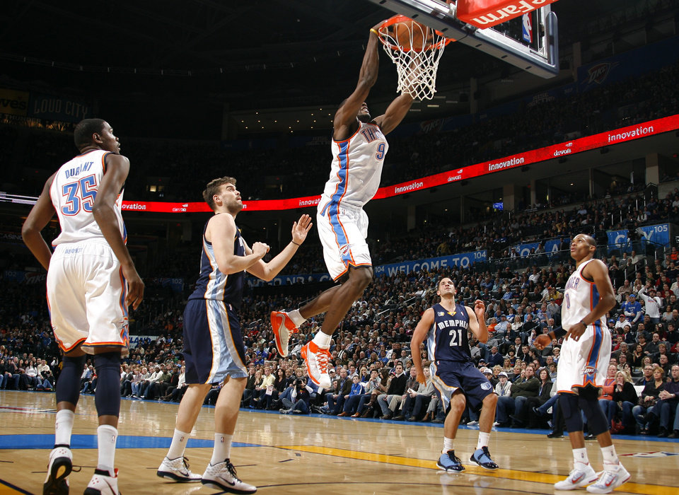 Oklahoma City's Serge Ibaka (9) dunks during the NBA basketball game between the Oklahoma City Thunder and the Memphis Grizzlies, Saturday, Jan. 8, 2011, at the Oklahoma City Arena. Photo by Sarah Phipps, The Oklahoman