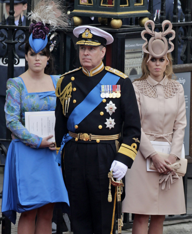 Photo - Britain's Prince Andrew, center, and his daughters Britain's Princess Eugenie, left, and Britain's Princess Beatrice leave Westminster Abbey at the Royal Wedding in London Friday, April, 29, 2011. (AP Photo/Gero Breloer)