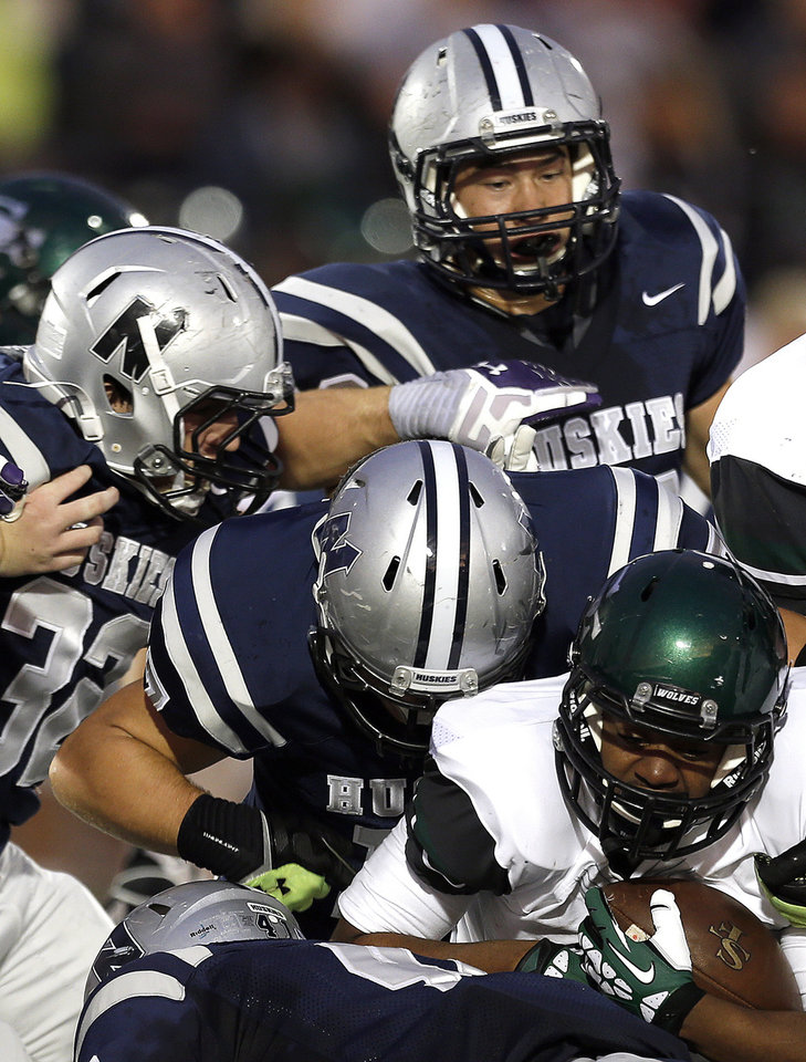 Edmond Santa Fe's Chase Crenshaw is tackled by the Edmond North defense during the high school football game between Edmond North High School and Edmond Santa Fe High School at Wantland Stadium in Edmond, Okla.,  Friday, Sept. 20, 2013. Photo by Sarah Phipps, The Oklahoman