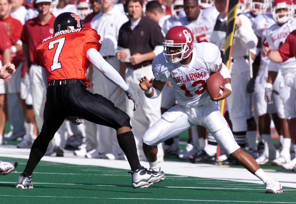 Former Oklahoma receiver Damian Mackey tries to make it past Texas Tech defender Anthony Malbrough. OKLAHOMAN ARCHIVE PHOTO