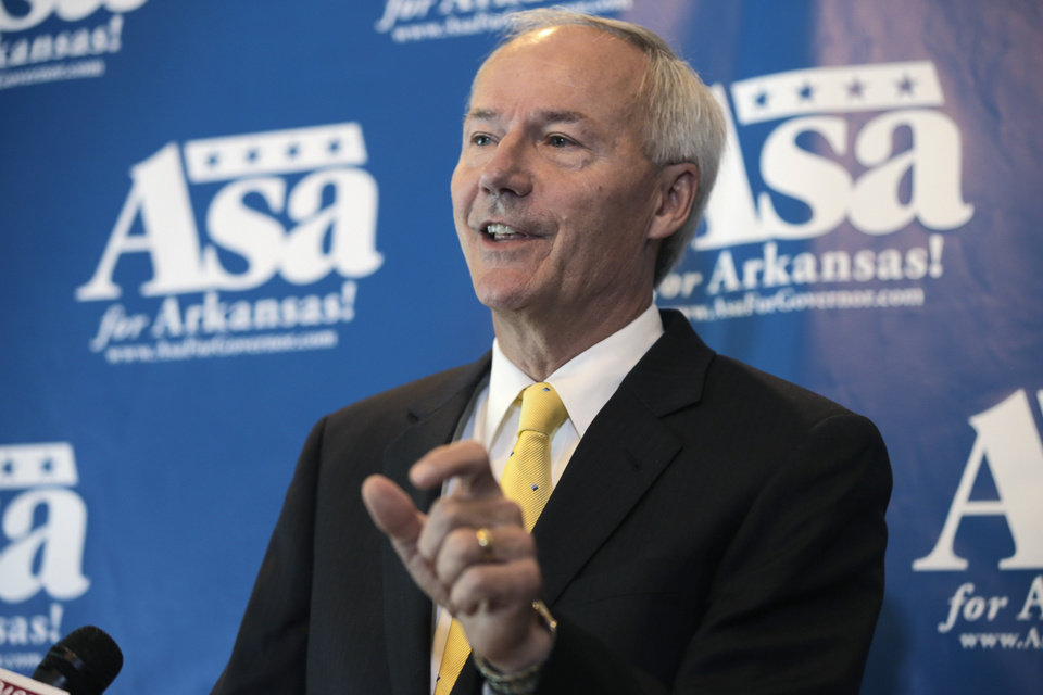 Photo - Republican candidate for Arkansas governor Asa Hutchinson tells reporters in Little Rock, Ark., Monday, Aug. 4, 2014, that if he were governor he would push for Arkansas to join 12 other states that have joined to challenge the Environmental Protection Agency's proposal to cut carbon-dioxide emissions by 30 percent by 2030. (AP Photo/Danny Johnston)