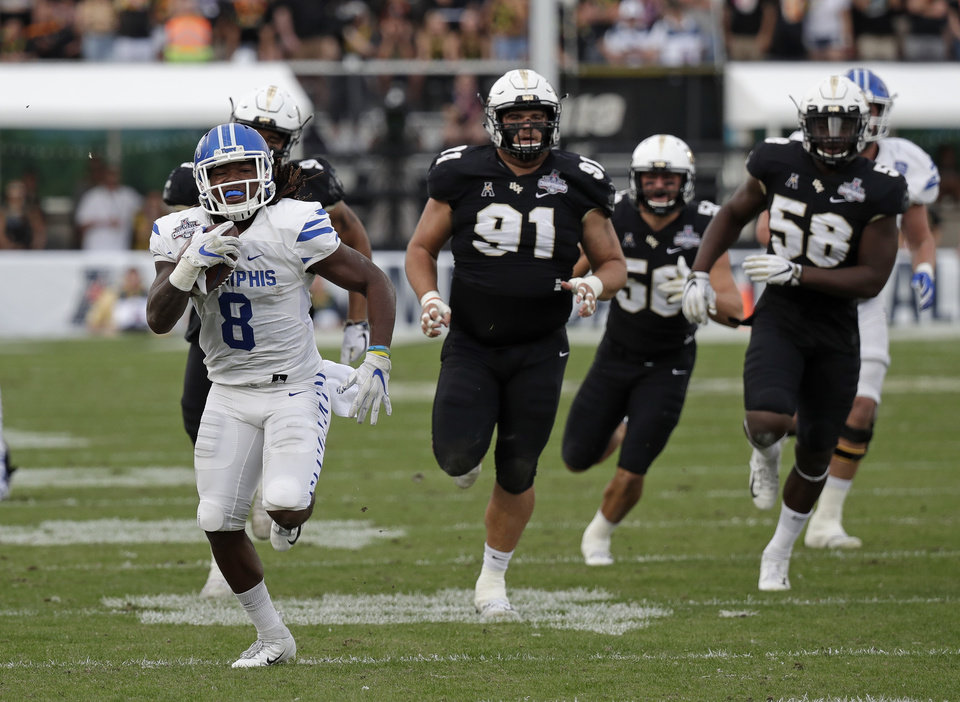 Photo - A common sight this season during Memphis games: Running back Darrell Henderson leaving defenders in his rear-view mirror. [AP PHOTO]