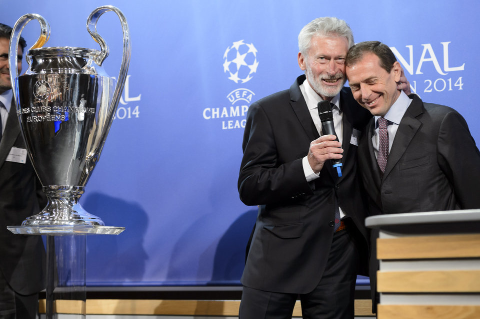 Photo - FC Bayern Muenchen club ambassador Paul Breitner, left, cheers with Real Madrid C.F. institutional Relations Director Emilio Butragueno, left, after the draw of the semi-finals of UEFA Champions League 2013/14 at the UEFA Headquarters in Nyon, Switzerland, Friday, April 11, 2014. (AP Photo/Keystone/Laurent Gillieron)