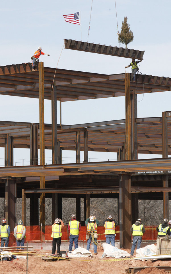 Photo - Feb. 27, 2012: The highest beam is lifted into place as Mercy Edmond holds their topping out ceremony and blessing of the new facility in Edmond. [Photo by Paul Hellstern, The Oklahoman Archives]