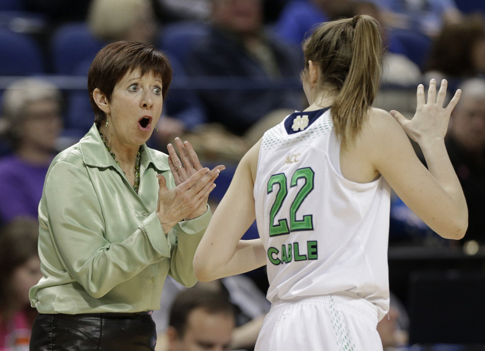Photo - Notre Dame head coach Muffet McGraw, left, talks with Madison Cable, right, during the first half of an NCAA college basketball semifinal game against North Carolina State at the Atlantic Coast Conference tournament in Greensboro, N.C., Saturday, March 8, 2014. (AP Photo/Chuck Burton)