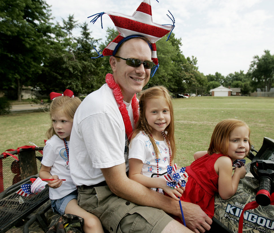 L to R - Hadley Moses ,5, Mark Moses, Hensley Moses ,6, and Avery Moses ,3, took part in the Brookhaven 4th of July parade Saturday July 4, 2009 in Norman. Photo by Jaconna Aguirre, The Oklahoman.