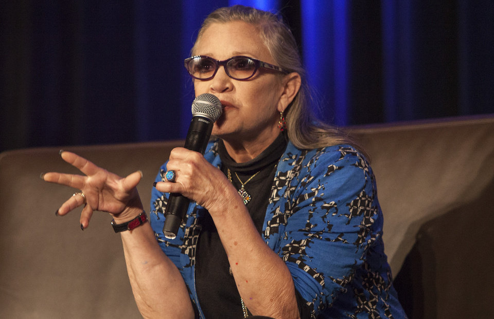 Photo -  Carrie Fisher talks during the Wizard World Chicago Comic-Con at the Donald E. Stephens Convention Center in Chicago in August. [Photo by Barry Brecheisen/Invision/AP]