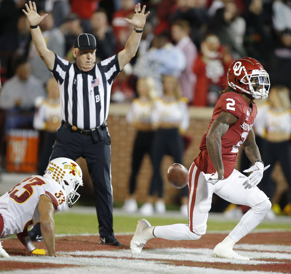 Photo - Oklahoma's CeeDee Lamb (2) celebrates in front of Iowa State's Braxton Lewis (33) after scoring a touchdown during an NCAA football game between the University of Oklahoma Sooners (OU) and the Iowa State University Cyclones at Gaylord Family-Oklahoma Memorial Stadium in Norman, Okla., Saturday, Nov. 9, 2019. [Bryan Terry/The Oklahoman]