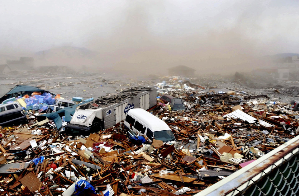 Photo - Cars and other Debris swept away by tsunami tidal waves are seen in Kesennuma in Miyagi Prefecture, northern Japan, after strong earthquakes hit the area Friday, March 11, 2011. (AP Photo/Keichi Nakane, The Yomiuri Shimbun)  JAPAN OUT, CREDIT MANDATORY ORG XMIT: TOK828