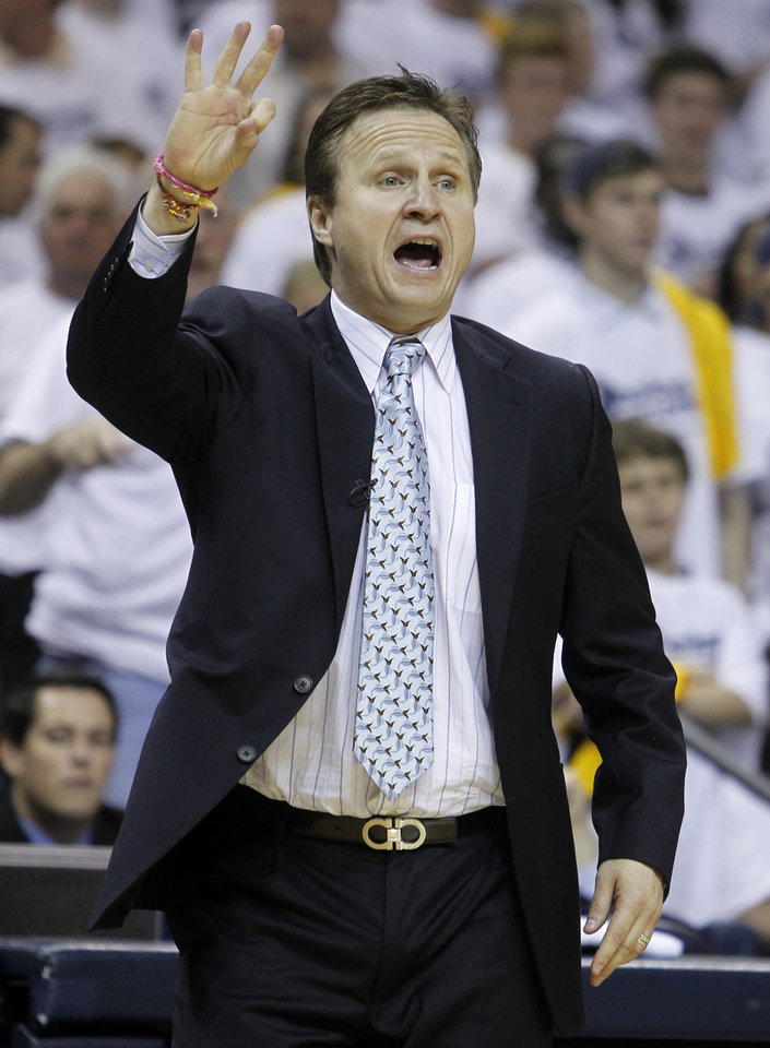 Oklahoma City Thunder head coach Scott Brooks directs his players during the second half of Game 4 against the Memphis Grizzlies in a second-round NBA basketball playoff series on Monday, May 9, 2011, in Memphis, Tenn. (AP Photo/Lance Murphey)