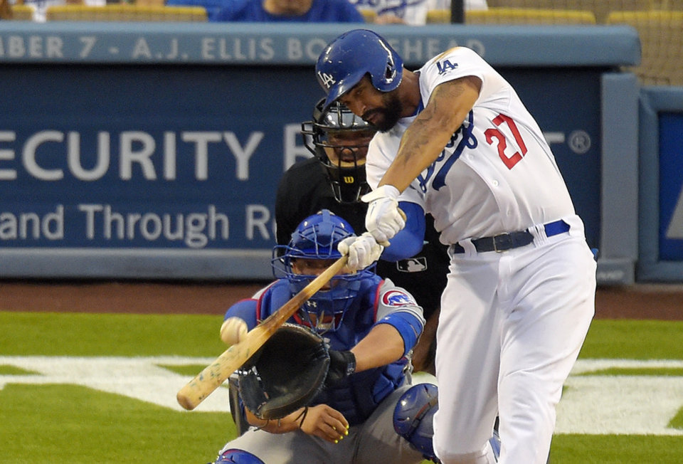Photo - Los Angeles Dodgers' Matt Kemp, right, hits a two-run home run as Chicago Cubs catcher Welington Castillo, left, and home plate umpire Tony Randazzo look on during the fourth inning of a baseball game, Saturday, Aug. 2, 2014, in Los Angeles. (AP Photo/Mark J. Terrill)