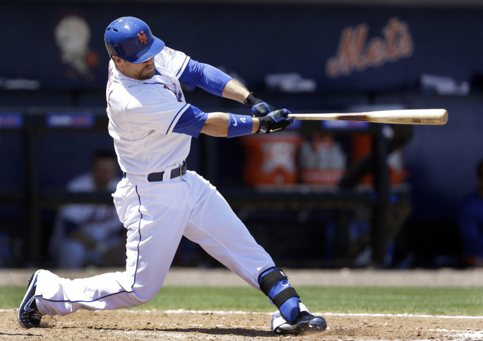 Photo - New York Mets' Collin Cowgill hits a two-run home run during the fourth inning of an exhibition spring training baseball game against the St. Louis Cardinals, Friday, March 29, 2013, in Port St. Lucie, Fla. (AP Photo/Jeff Roberson)