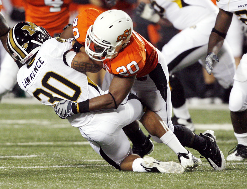 Photo - Andre Sexton tackles Kendial Lawrence (30) during the college football game between Oklahoma State University (OSU) and the University of Missouri (MU) at Boone Pickens Stadium in Stillwater, Okla. Saturday, Oct. 17, 2009.  Photo by Steve Sisney, The Oklahoman