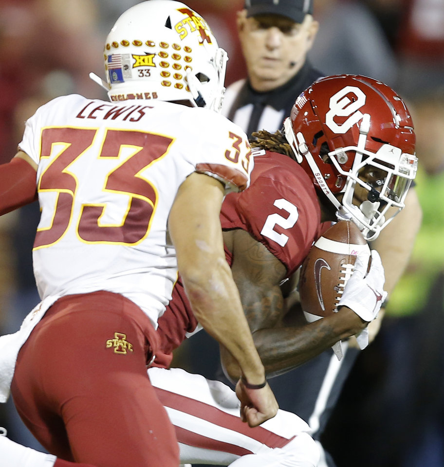 Photo - Oklahoma's CeeDee Lamb (2) scores a touchdown in front of Iowa State's Braxton Lewis (33) during an NCAA football game between the University of Oklahoma Sooners (OU) and the Iowa State University Cyclones at Gaylord Family-Oklahoma Memorial Stadium in Norman, Okla., Saturday, Nov. 9, 2019. [Bryan Terry/The Oklahoman]