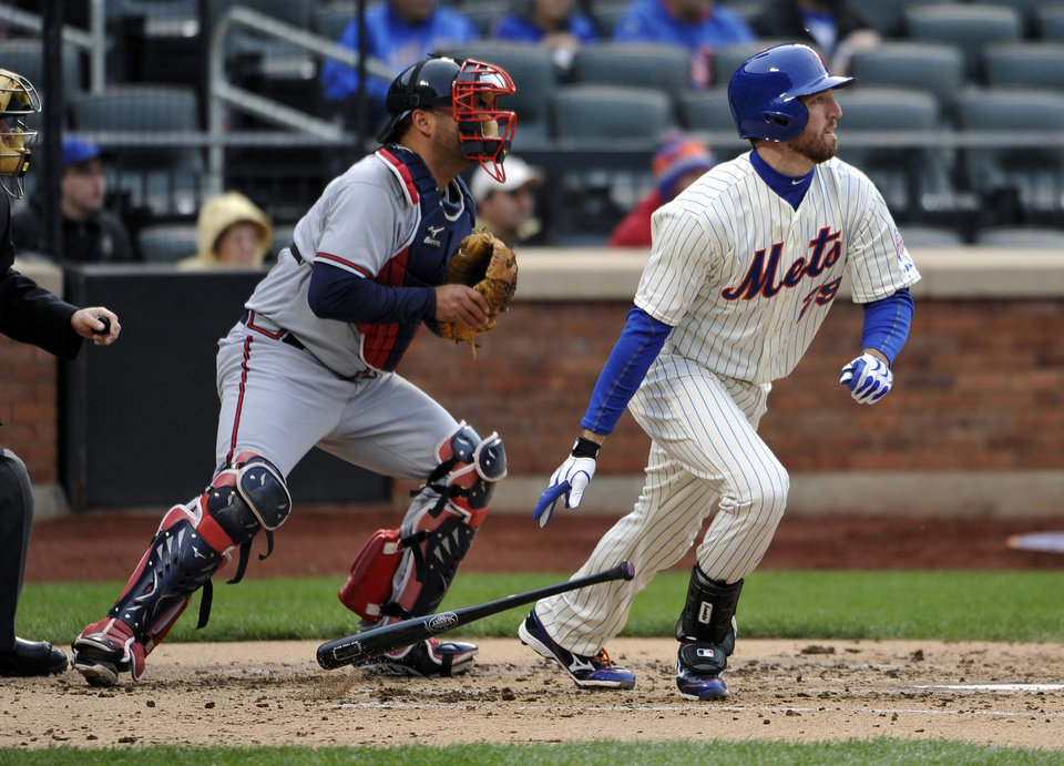 New York Mets' Ike Davis, right, hits a single off Atlanta Braves relief pitcher Craig Kimbrel in the tenth inning of a baseball game that was suspended from Friday night at Citi Field, Saturday, May 25, 2013 in New York. The Braves won 7-5. (AP Photo/Kathy Kmonicek)