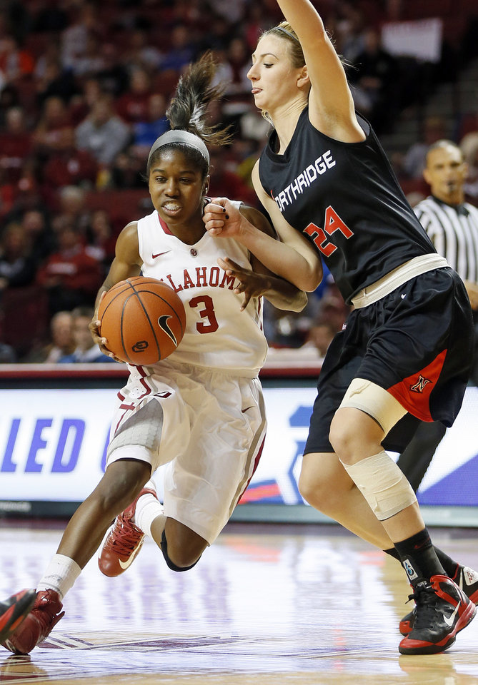 Photo - Oklahoma's Aaryn Ellenberg (3) drives against Cal State Northridge's Marta Masoni (24) in the second half during a women's college basketball game between the University of Oklahoma (OU) and Cal State Northridge at the Lloyd Noble Center in Norman, Okla., Saturday, Dec. 29, 2012. OU won, 79-57.  Photo by Nate Billings, The Oklahoman