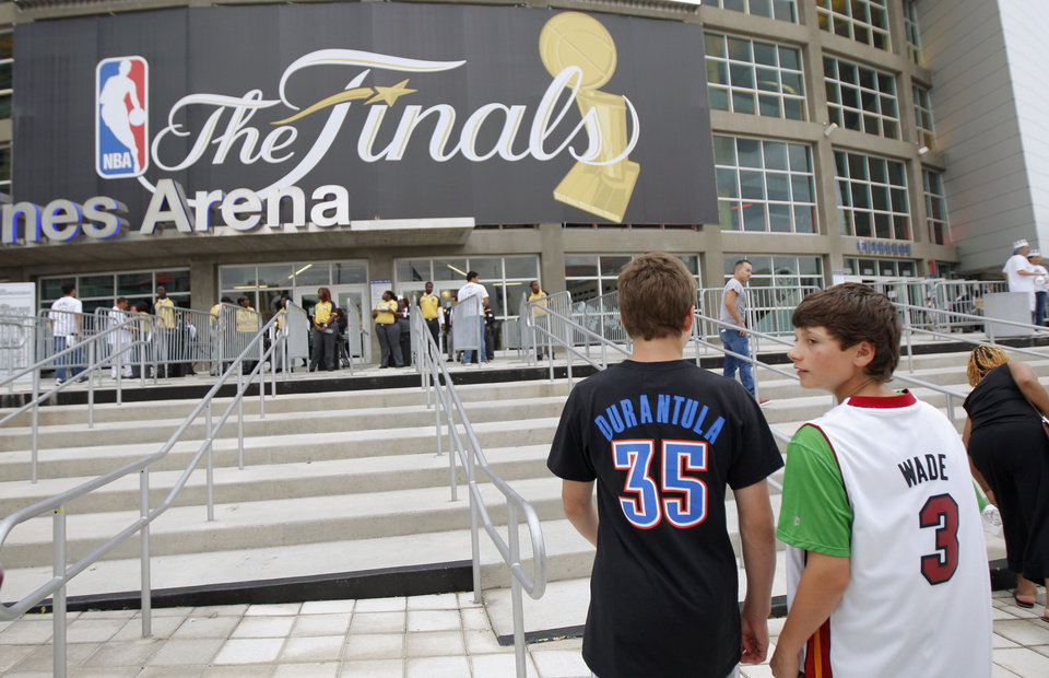 Corey McPoland, 14, at left, and Zach Mitchell, 14, of Buffalo, New York, make their way into the arena before Game 4 of the NBA Finals between the Oklahoma City Thunder and the Miami Heat at American Airlines Arena, Tuesday, June 19, 2012. Photo by Bryan Terry, The Oklahoman