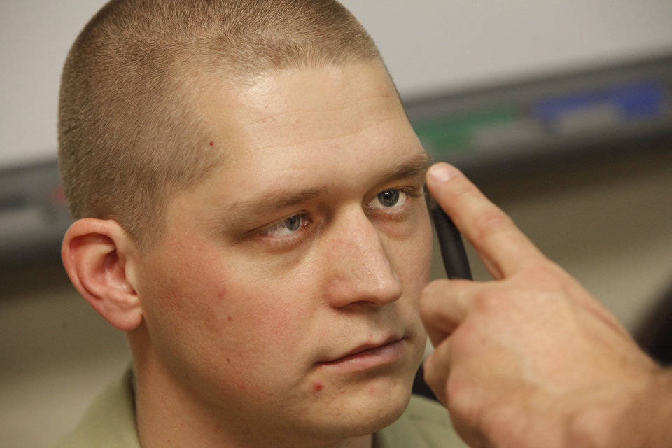 Photo -      Oklahoma Highway Patrol cadet Kaleb Kemp follows a pen with his eyes as an example of a field test for drugs conducted by law officers. Photo by David McDaniel, The Oklahoman   David McDaniel -