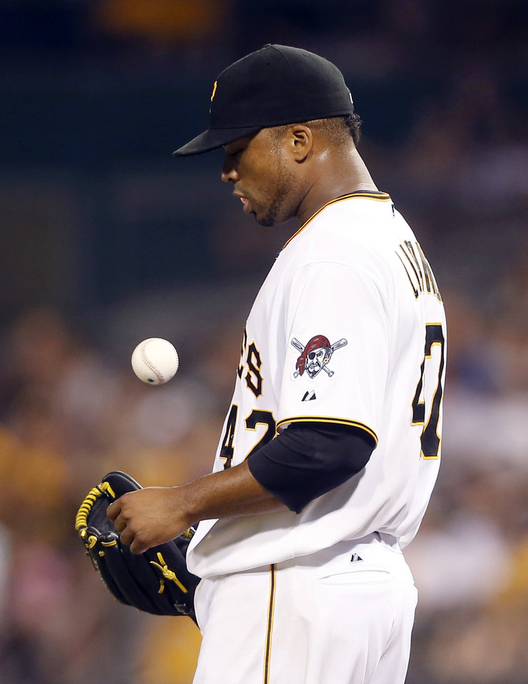 Photo - Pittsburgh Pirates starting pitcher Francisco Liriano tosses the ball to himself after giving up a single to Atlanta Braves' B.J. Upton that drove in a run in the fifth inning of the baseball game on Tuesday, Aug. 19, 2014, in Pittsburgh. Liriano was lifted right after. (AP Photo/Keith Srakocic)