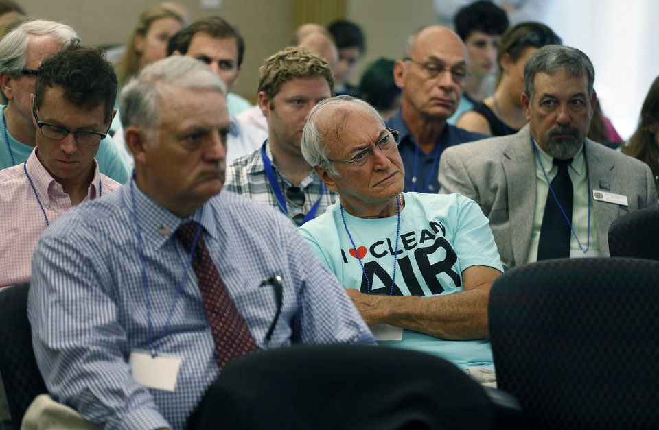 Photo - Attendees listen to testimony on the first of two days of public hearings held by the Environmental Protection Agency on President Barack Obama's plan to cut carbon dioxide emissions by 30 percent by 2030, in Denver, Tuesday, July 29, 2014. In hearings, hundreds of people across the country are telling the EPA its new rules for power-plant pollution either go too far or not far enough. (AP Photo/Brennan Linsley)