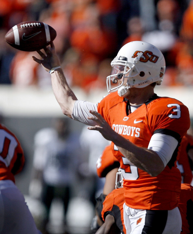 OSU's Brandon Weeden completes a pass in the fourth quarter set an OSU single game passing record during the college football game between the Oklahoma State University Cowboys (OSU) and the Baylor University Bears at Boone Pickens Stadium in Stillwater, Okla., Saturday, Nov. 6, 2010. Photo by Sarah Phipps, The Oklahoman