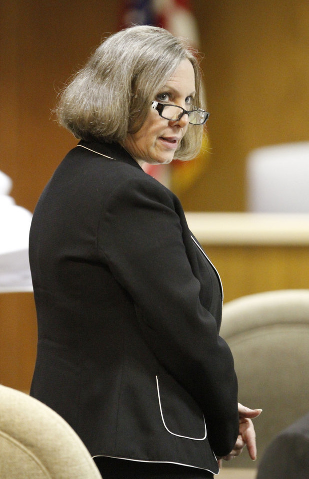 Rebecca Bryan stands as jurors leave the courtroom Wednesday during her murder trial in the Canadian County Courthouse in El Reno. <strong>Steve Gooch - The Oklahoman</strong>