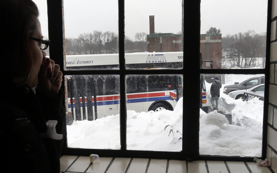 Xiomary Cosme of Haverhill, Mass. waits for her bus at the MRTA station in Haverhill, Mass. Monday, Feb. 11, 2013. State officials urged commuters to take public transportation when possible. The MBTA's regularly scheduled service resumed Monday, but some trolley and commuter rail lines were experiencing delays due to signal problems and weather-related issues. (AP Photo/Elise Amendola)